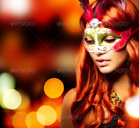 Masquerade. Beautiful Girl in a Carnival mask - Stock Photo - Images