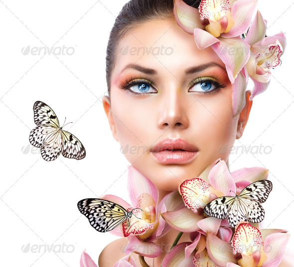 Beautiful Girl With Orchid Flowers and Butterfly - Stock Photo - Images