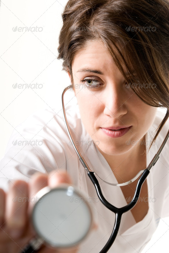Young woman doctor with stethoscope - Stock Photo - Images