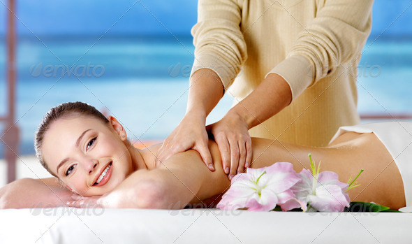 Smiling girl  getting spa massage - Stock Photo - Images