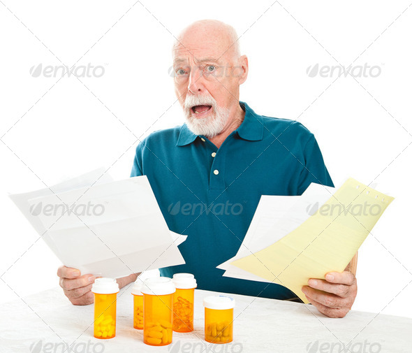 Senior Overwhelmed by Medical Costs - Stock Photo - Images