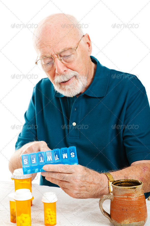 Senior Man Sorting Pills - Stock Photo - Images