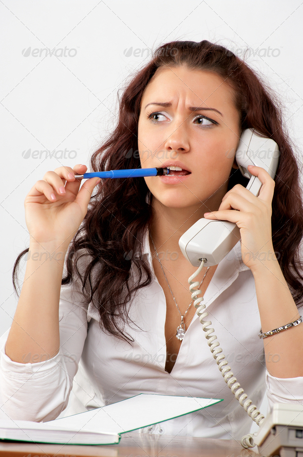 Young beautiful business woman talking phone - Stock Photo - Images