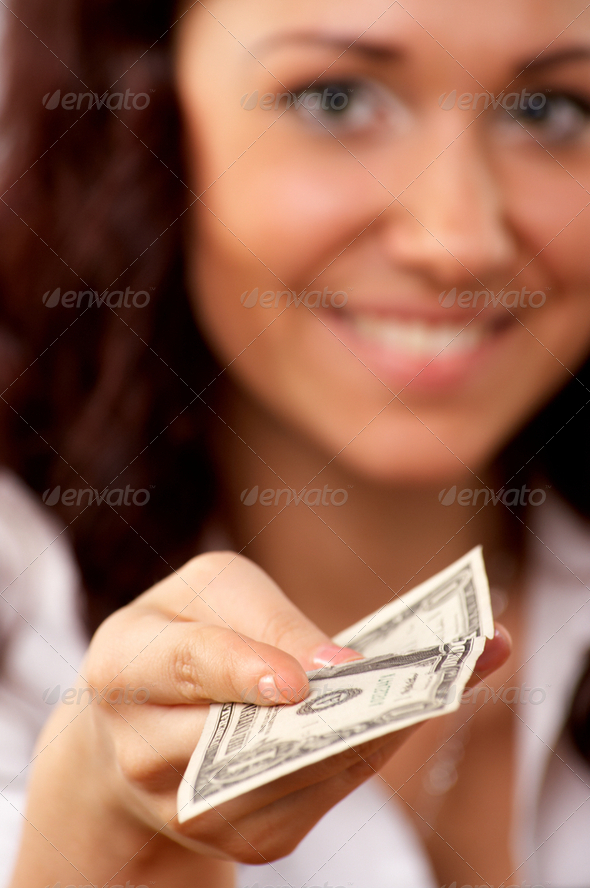 Young woman hand holding one dollar - Stock Photo - Images