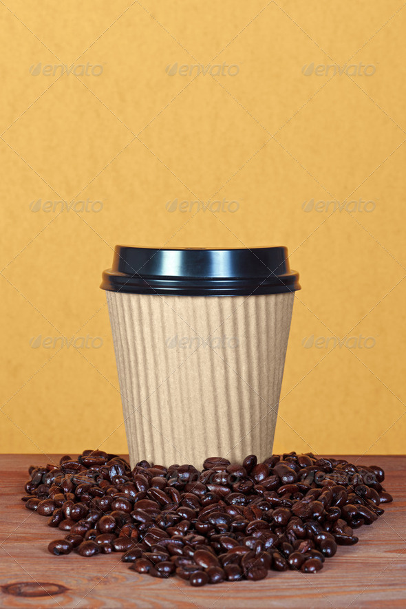 Takeaway paper coffee cup with beans - Stock Photo - Images