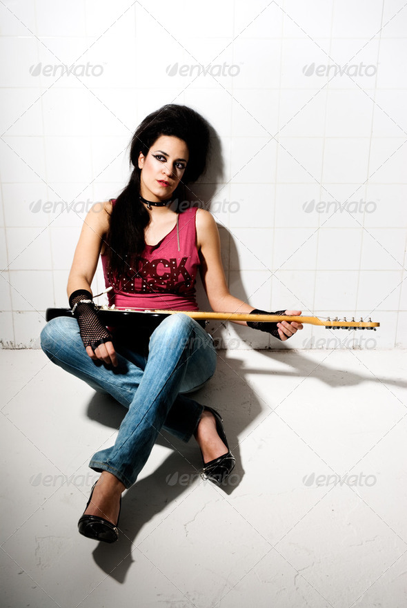 Female playing electric guitar - Stock Photo - Images