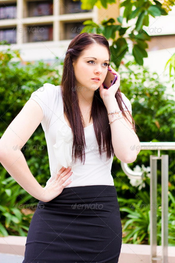 Unhappy Business Woman Talking On Cell Phone - Stock Photo - Images