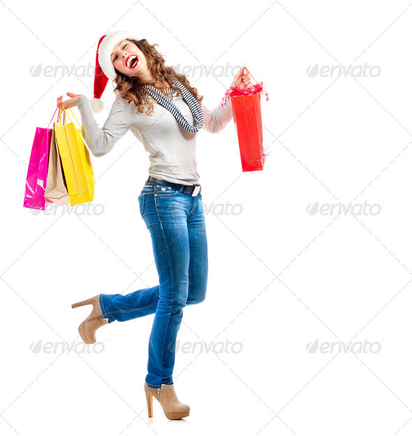 Christmas Shopping. Woman with Bags over White. Sales - Stock Photo - Images
