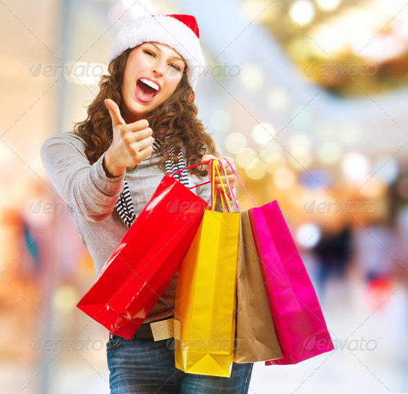 Christmas Shopping. Girl With Bags in Shopping Mall - Stock Photo - Images