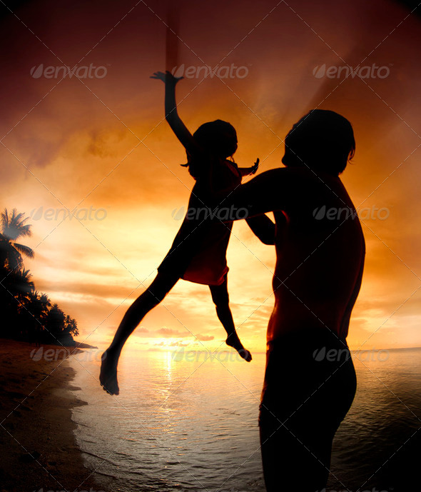silhouette family of child hold on father - Stock Photo - Images