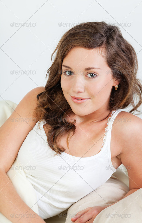 Pretty young woman in bed - Stock Photo - Images