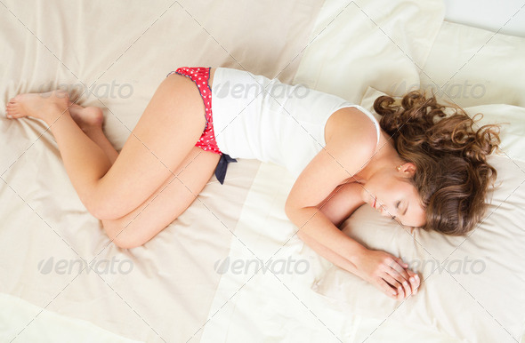 Sleeping young woman - Stock Photo - Images
