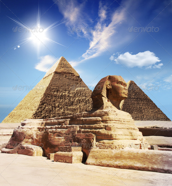 Egyptian sphinx and pyramid  - Stock Photo - Images