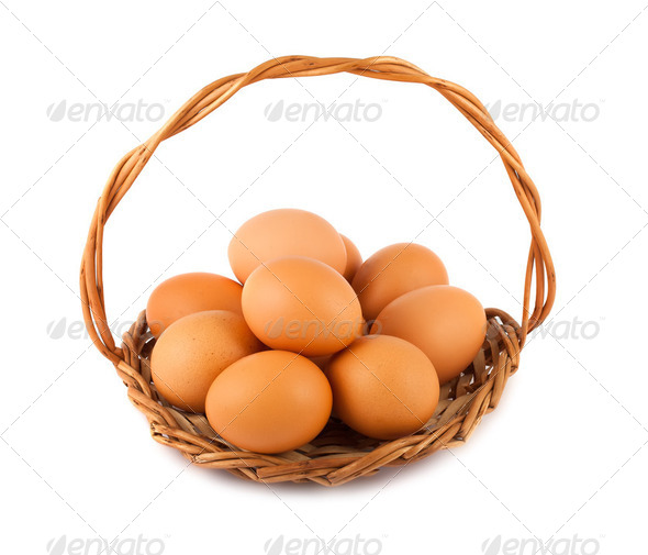 Brown chicken eggs on wicker basket - Stock Photo - Images