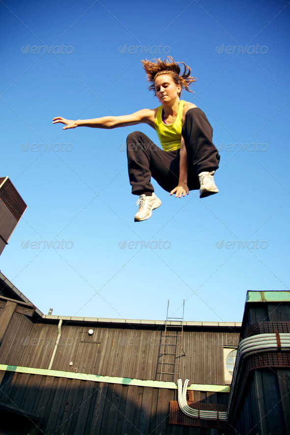 Traceur Demonstrating Parkour - Stock Photo - Images