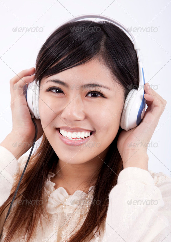 Happy Asian girl with headphone - Stock Photo - Images