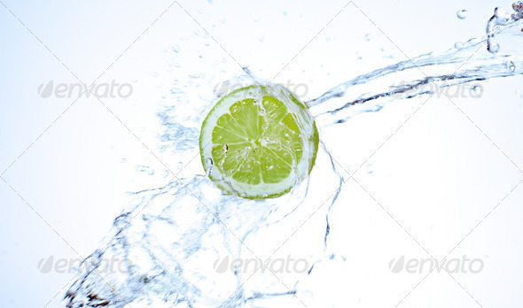 Fresh lime splashing underwater - Stock Photo - Images