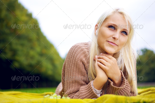 Female listening to music and relaxing - Stock Photo - Images