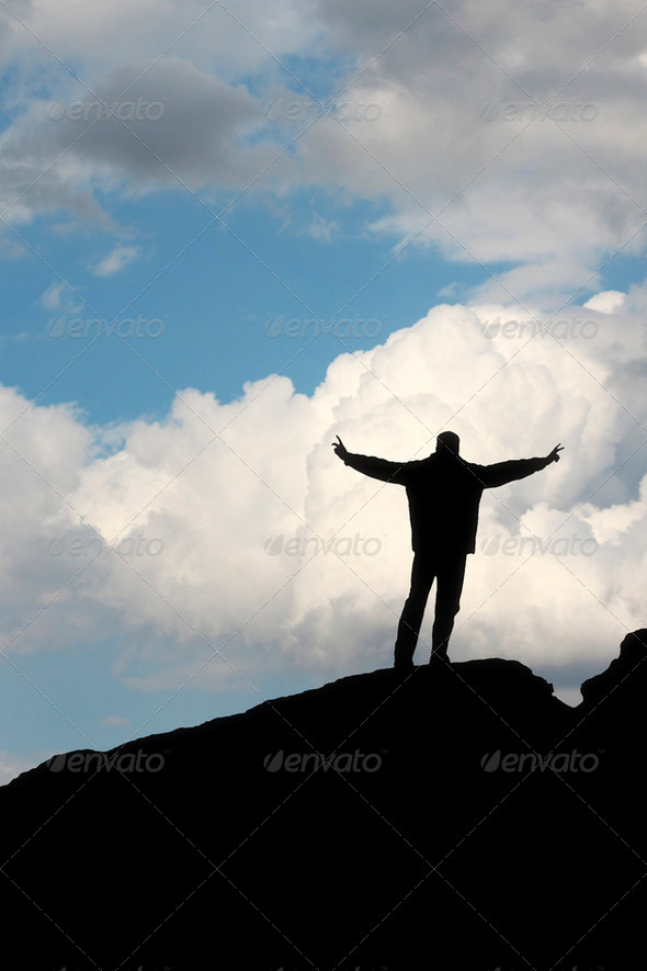silhouette of a man in front of the blue sky - Stock Photo - Images