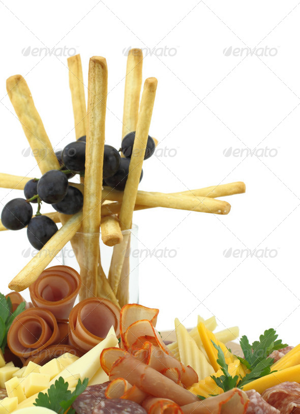 Meat delicatessen plate with cheese and grissini - Stock Photo - Images