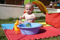 A child playing with water in the garden - PhotoDune Item for Sale