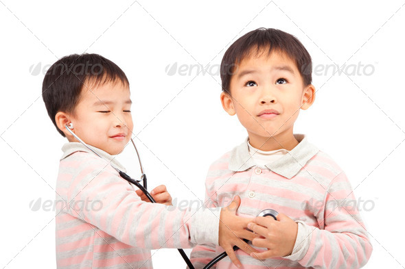 two boys using stethoscope Check the heartbeat - Stock Photo - Images