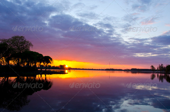 summer lake sunset. Boats sky reflections water - Stock Photo - Images