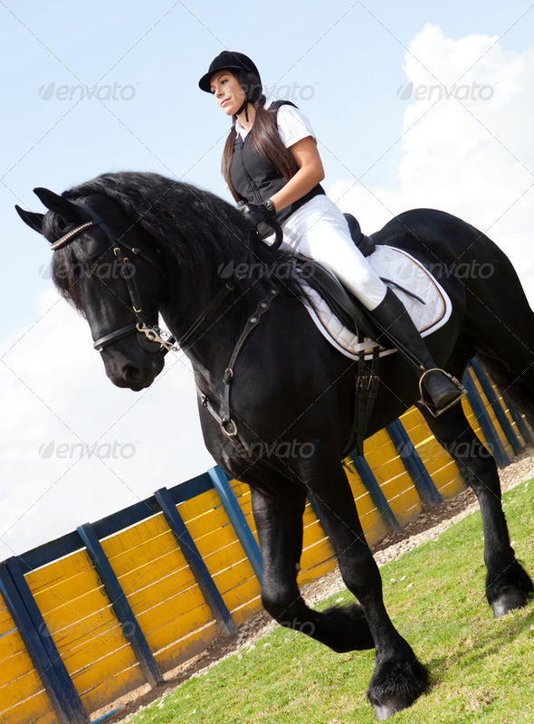 Female jockey riding - Stock Photo - Images