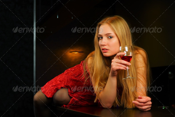Young Woman In A Night Bar - Stock Photo - Images