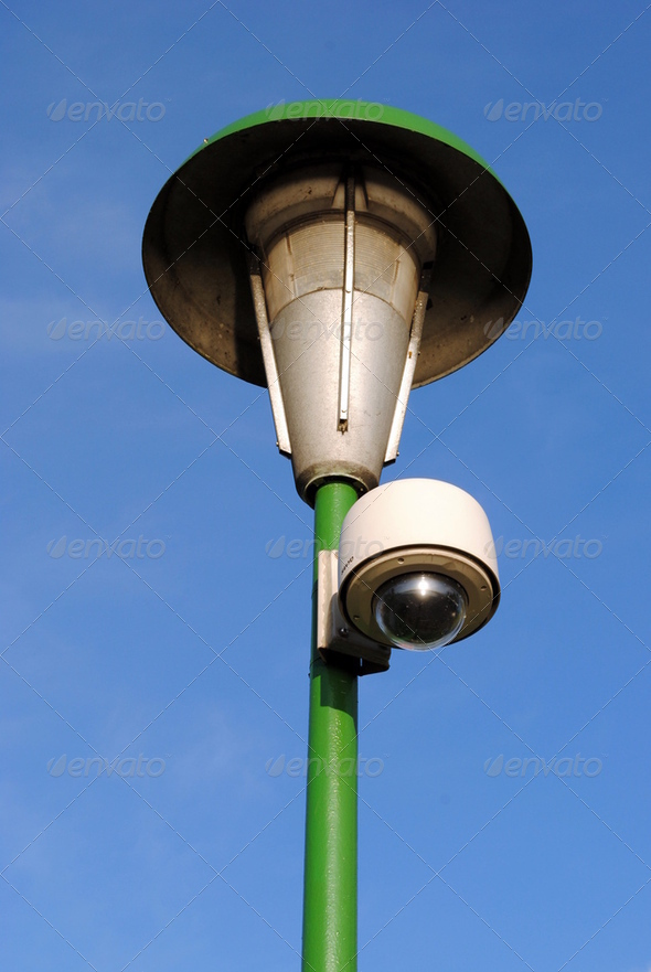 speed dome on a green street lamp - Stock Photo - Images