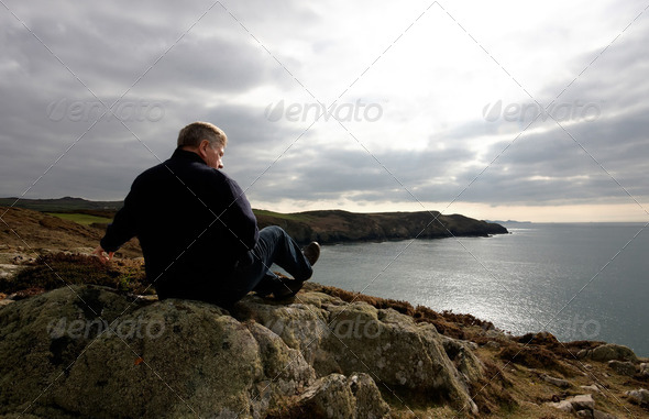 Mature man looking out to sea - Stock Photo - Images