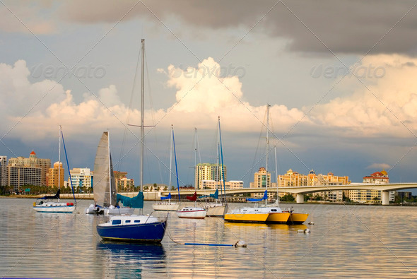 Boats in Harbor Under Cloudy Skies - Stock Photo - Images