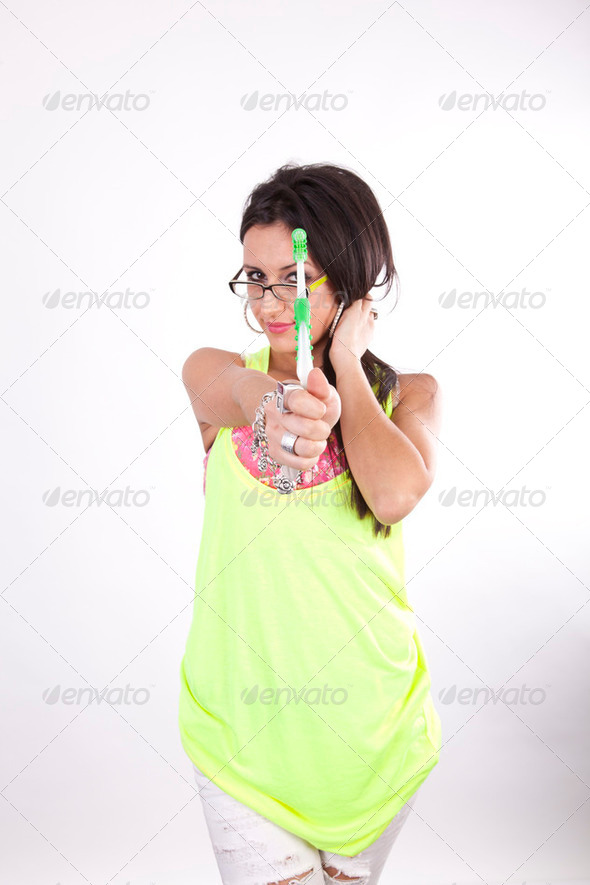 Young attractive girl showing toothbrush - Stock Photo - Images