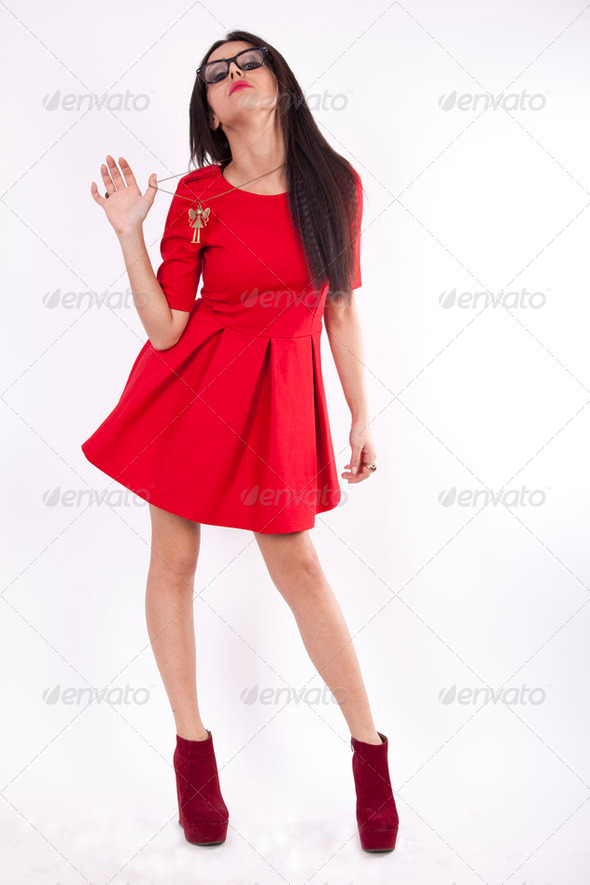 Young attractive sexy woman in red dress - Stock Photo - Images