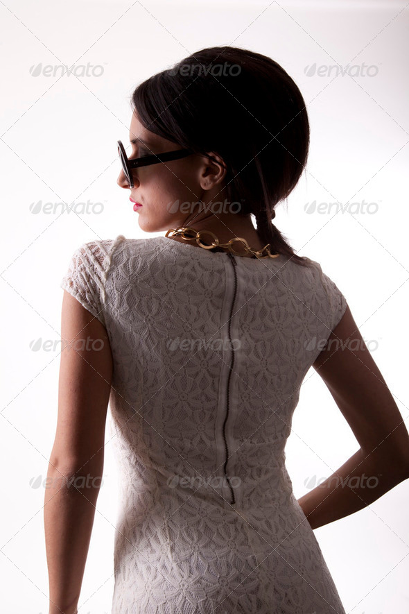 Young attractive sexy woman in white dress - Stock Photo - Images
