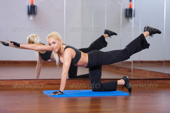 Woman at the gym - Stock Photo - Images