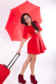 Young attractive sexy woman in red dress with red umbrella - PhotoDune Item for Sale