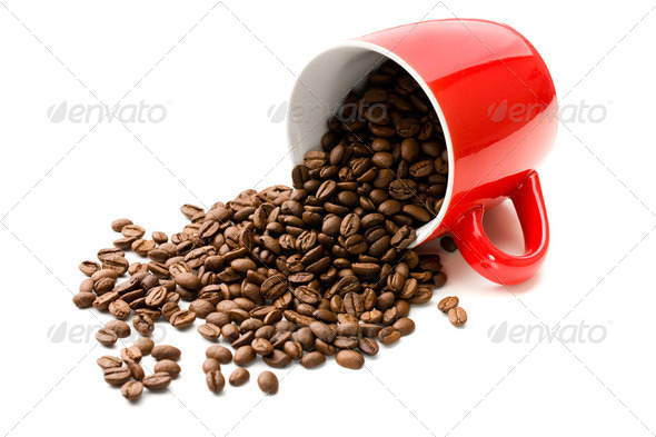 colorful mug with coffee beans - Stock Photo - Images