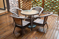 wicker chairs and table on hardwood front deck - PhotoDune Item for Sale