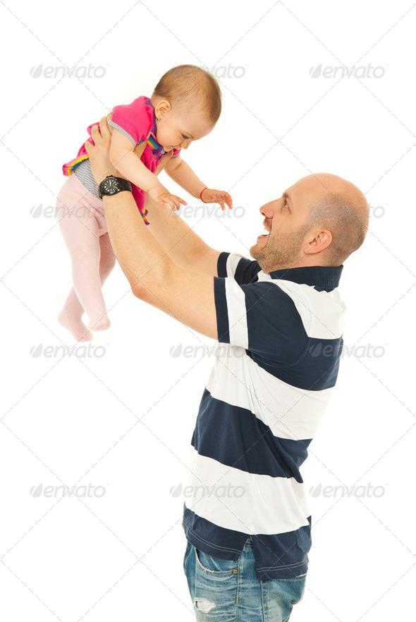 Happy father playing with baby - Stock Photo - Images