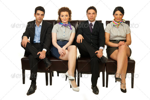 Four business people on chairs - Stock Photo - Images
