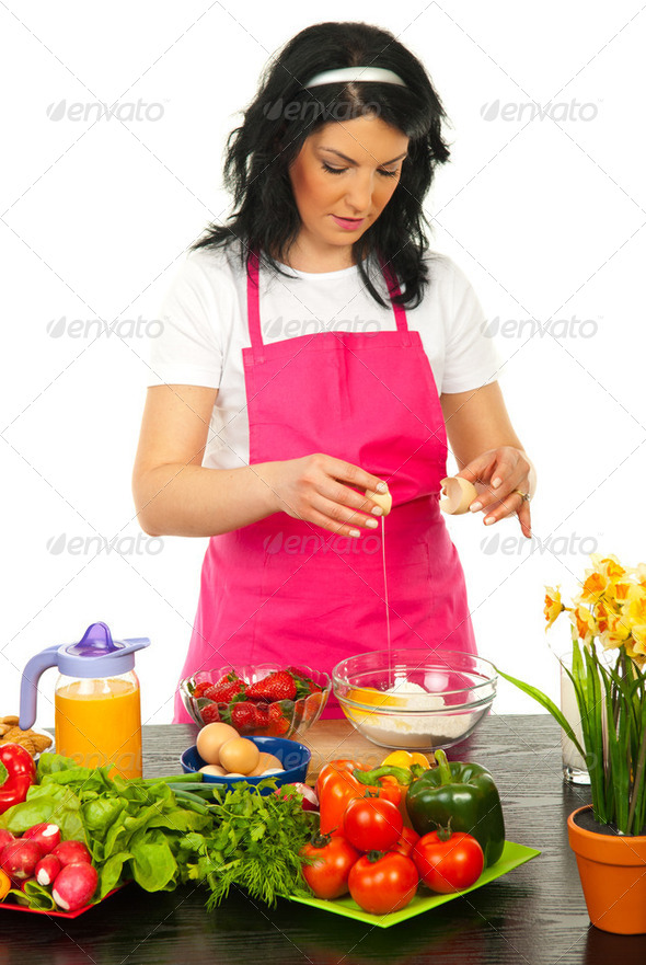 Woman put egg in flour - Stock Photo - Images