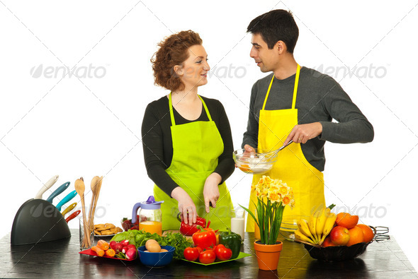 Happy couple cooking together - Stock Photo - Images