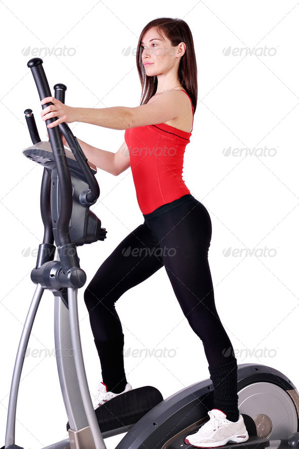 Girl fitness exercise with cross trainer  - Stock Photo - Images