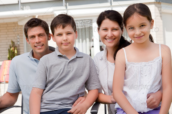 Portrait of smiling young family together - Stock Photo - Images