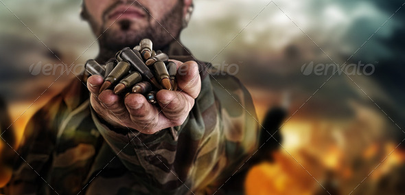 army war concept , military warrior with a handful of bullets ag - Stock Photo - Images