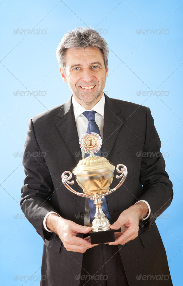 Senior businessmen holding a trophy - Stock Photo - Images