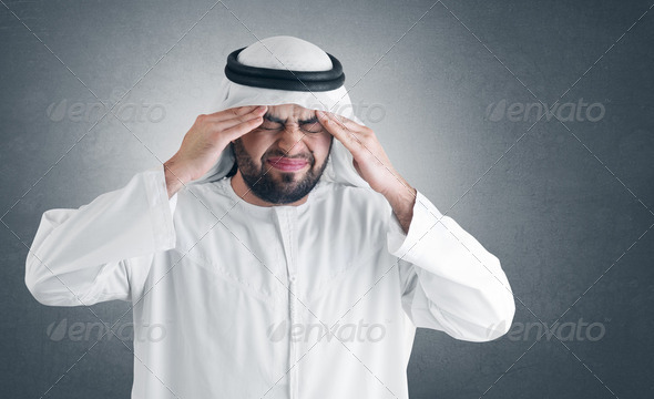 arabian man having a headache- clipping path included for isolation - Stock Photo - Images