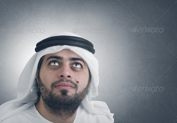traditional arabian businessman thinking with space for graphic or text - Stock Photo - Images
