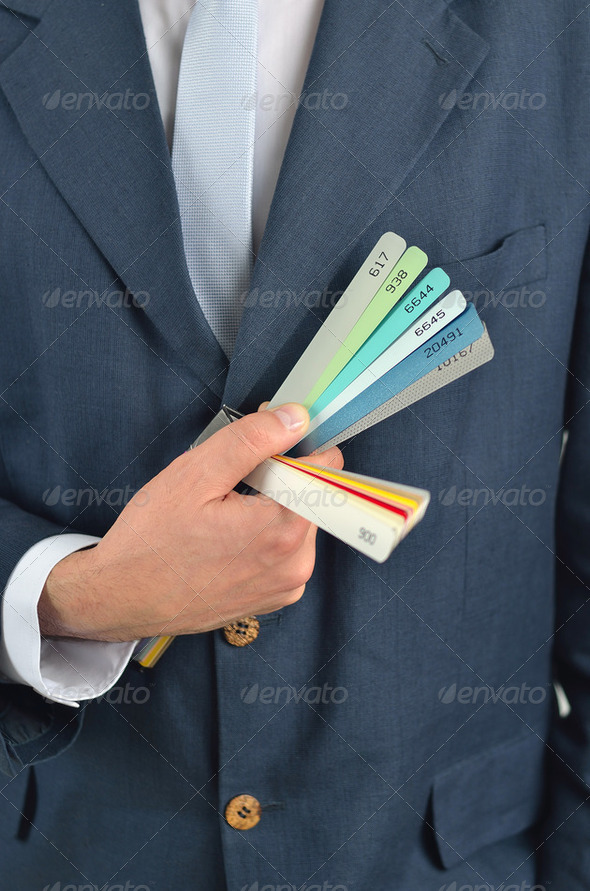 Businessman holding color guide book isolated on white background - Stock Photo - Images